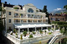 Villa Elena Hotel & Residences Yalta This classical 5-star hotel on the Black Sea coast offers Mediterranean cuisine and air-conditioned accommodation with balconies and free Wi-Fi. It stands within green gardens, 20 metres from Yalta's promenade.