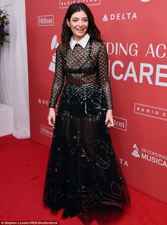 Hot mesh! Lorde, 21, went solo on her red carpet appearance at the Musicares Person Of The Year gala at Radio City Music Hall on New York on Friday