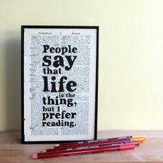 Book Lover's quote typographic art printed on framed vintage book page.