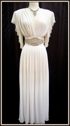 This one of a kind 1940's gown is approximately a size 10 - 12 and is