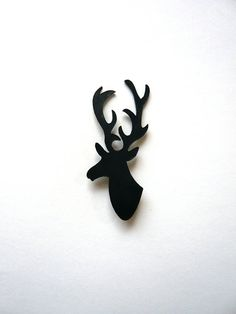 Leather stag's head badge  black by afterWARD on Etsy, £4.50