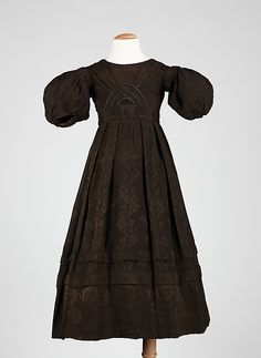 This is a child's dress from the early 1830s, the Romantic period, in which sleeves became quite large, making the wearer look like butterflies.