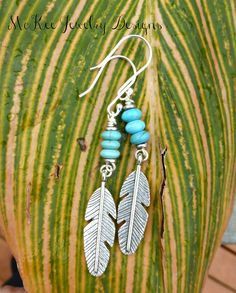 These lightweight beauties are made with blue turquoise howlite stone and silver feather charms with sterling silver ear wires. Total earring length is about 3 inches and 1/2 inch wide. As with all of