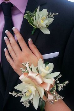 prom flowers Prom Corsage and Boutonniere in Peabody . Prom Corsage And Boutonniere, Groom Boutonniere, Boutonnieres, Prom Wrist Corsage, Orchid Corsages, Flower Corsage, Bracelet Corsage, Bridal Bracelet, Prom Flower Bracelet