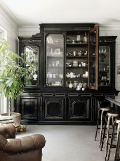AHHHH freestanding shelves & DARK in the kitchen WHAT it looks like a victorian store I love it