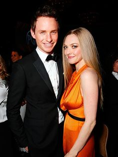 On-screen Les Misérables loves Eddie Redmayne and Amanda Seyfried make a pretty cute pair during the PGA cocktail reception.