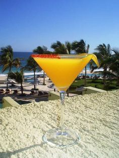 BEST MANGO MARTINI RECIPE    1 oz Captain Morgan® Parrot Bay mango rum  1/2 oz peach schnapps  1/2 oz Cointreau® orange liqueur  1 oz cranberry juice  1 oz pineapple juice      Combine all ingredients and shake lightly with ice. If you shake too hard the pineapple juice will get all foamy and will ruin the appearance (but not the taste) of the drink.     Strain into a cocktail glass, splash with sprite and serve with an orange wedge.