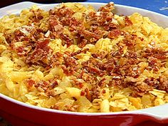 Mac and Cheese. Reg. Mustard, less nutmeg and cayenne pepper. +Parmesan and 6 slices Am Cheese.  Add 1tsp Paprika. Topping: Bread Crumbs instead of chips, Ritz Crackers+3tbs butter w/parm. cheese. Shells pasta....Excellent!