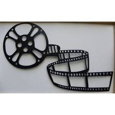 Home Theater Decor Movie Reel and Film  Metal Wall Art. $ 29.99, via Etsy.