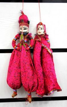 """(SKU no: wooden puppet statue_1) Ethnic home decor from India, handmade puppets by the craftsmen of Rajasthan, India. These are used to enhance interior beauty of houses, hotels and restaurants. These handmade puppets are also called Kathputli, which is a join of two Rajasthani language words i.e. """"Kath"""" meaning wood and """"Putli"""" meaning puppet. Kathputli means a puppet which is made from wood. Ethnic & Traditional decoration handcrafted in India."""