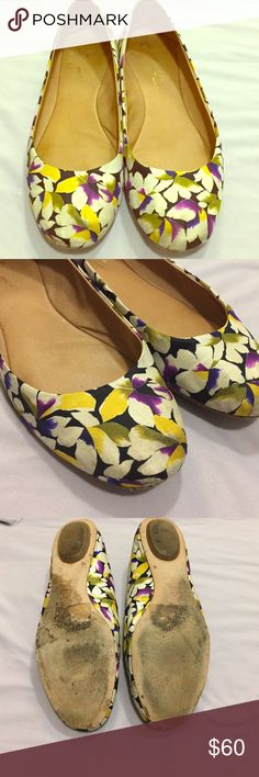 Anthropologie floral flats EUC- the white has been a little discolored from wearing as shown in the pictures but not to the point where they are unprofessional or not suitable for work. The colors are so unique! (Purple, yellow, black, white and moss green) Anthropologie Shoes Flats & Loafers