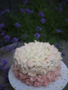 White chocolate cake with white chocolate icing (tinted pink)