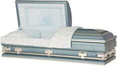 "Steel Casket, 28"" Over-sized Mariner, 20 Gauge Steel, Sky Blue shaded Silver, Light Blue Crepe Interior, Sunburst Panel. Also available in 30"", 33"", 36"". Oversized vault required for 30""+. Price: $1,595.00"