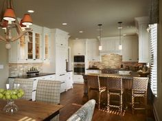 Love these white cabinets with dark granite countertops and dark brown hardwood floors.