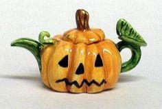 Sally Meekins Ceramics small Halloween jack-o'-lantern teapot, wrinkled pumpkin orange body with vine green spout and handle, stem as knob, ceramic, UK