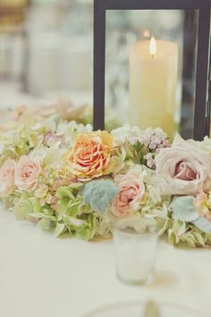 soft color low arrangement with candle