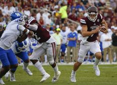 Nick Fitzgerald #7 of the Mississippi State Bulldogs carries the ball during the first half of an NCAA football game against the Mississippi State Bulldogs at Davis Wade Stadium on October 21, 2017 in Starkville, Mississippi.