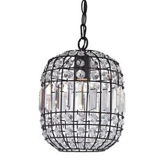 A dark bronze cage is decorated with cut crystal drops, the center portions shows long coffin crystals, each crystal shimmers and sparkles reflecting light and creating ambience.
