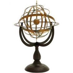 Metal armillary decor.   Product: Armillary décorConstruction Material: MetalColor: BronzeFeatures:  Center sphere represents the Earth or the Sun, while the rotating rings represent other orbiting starsIdeal for the living room end table or in the home office Dimensions: 22 H x 14 Diameter