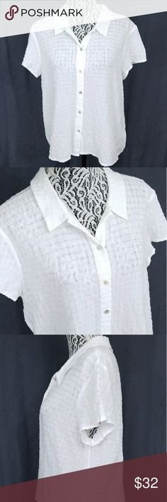 """Eileen Fisher White Button Up Cotton Top Size M Eileen Fisher Women's Button Up Short Sleeved Organic Cotton Blouse in White - Size Medium  Features: Linen, lightweight Mother of pearl buttons Collared, button down neckline Short sleeves Waffle geometric square texture 99% Organic Cotton 1% Spandex  Excellent condition (EUC). No stains or holes.  Marked Women's M  Flat measurements: Armpit to Armpit 20.5"""" Sleeve Length 6"""" Total Length 24"""" Eileen Fisher Tops Button Down Shirts"""