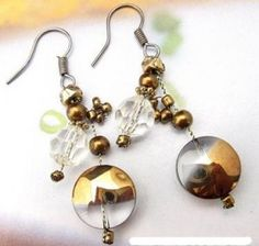 Whether it's for a birthday or anniversary, or simply just-because, these lovely earrings will bring out her smiles. Made from colored glazed glass, acrylic and metal beads with classic silver coated hook. You can present them to your loved one on any occasion. This is very stylish design and it suits to any occasion.    Guarantee:100% Satisfaction for Material & Workmanship used in making this Jewelry