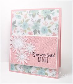 This challenge is to use vellum to soften a floral look.  So I simply attached the vellum to the dsp but then I wanted a front panel to show some more vellum so I punched the flowers out after embossing them in white.