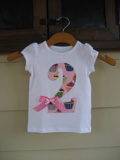 Appliqued Birthday Shirt:  http://www.etsy.com/listing/54765851/custom-appliqued-birthday-shirt-0-9?ref=v1_other_1