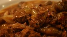 Delicious tender beef is cooked in the slow cooker with beer - Guinness(R) no less - shallots, bacon, and mushrooms for a hearty dinner.