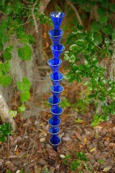 Cut off top of glass bottles arrange on post