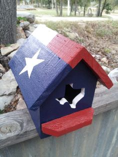 Texas flag birdhouse made out of old fencing material.