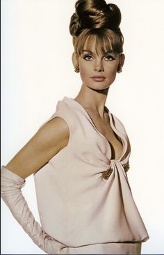 1963 Jean Shrimpton in pale pink crêpe de chine evening dress with a gold and ruby bar-clip by Christian Dior, photo by Iriving Penn used for cover of Vogue US