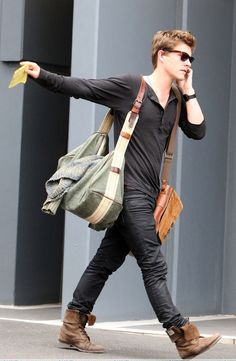 Those bags and boots.. The loose effortless long sleeve.. Shades and messy hair.. Love!