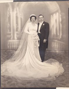 :::::::::: Vintage Photograph :::::::::: Wedding photograph of a lovely couple, her dress is so elegant!