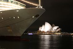 The Sydney Opera House on Bennalong Point, on the opposite side of Sydney Cove from the P cruise ship the Arcadia.