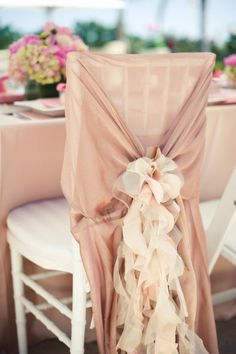 chair cover. Want to do this at least for pictures or for bride and groom to sit on at reception.