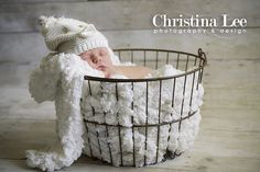 Precious baby in a basket! Blanket came from Ikea and the background is barnwood paper.
