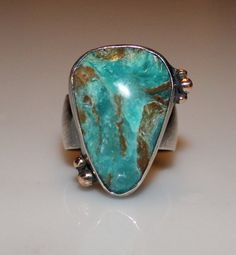 Think of an aerial view of the Caribbean... Peruvian opal with 14K gold and silver