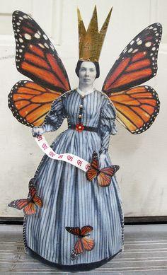 A true monarch fabric and encaustic art doll by Stephanie Rubiano