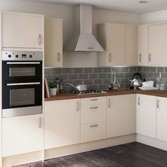 cream kitchen with grey tiles and wooden worktop - Google Search