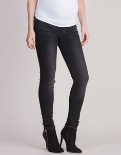 Soft stretch cotton denim   Comfy under bump band   Rock chic rip at the knee   Skinny cut    A rock chic staple for every mama's wardrobe, our Black Under Bump Ripped Skinny Maternity Jeans offer edgy style and ultimate comfort! Made in high performance stretch denim with a comfy under bump band, these flattering maternity skinny jeans work hard to smooth & sculpt your curves for a flexible fit at every stage of pregnancy. Ultra-slimming and artfully ripped at the knee, these will quic...