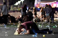 A man shields a woman during a mass shooting at the Route 91 HaA gunman perched on the 32nd floor of a Las Vegas Strip hotel unleashed a shower of bullets on the festival below, killing 58 people and wounding more than 500 as tens of thousands of frantic concertgoers ran for their lives. It was the deadliest mass shooting in modern U.S. history.rvest country music festival