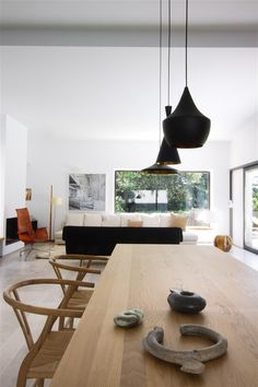 Tom Dixon Beat Lights and Carl Hansen Wishbone Chairs = big smiles :-)    http://www.nest.co.uk/product/tom-dixon-beat-light-fat-black    http://www.nest.co.uk/search/carl-hansen-ch24-wishbone-chair    Image via Home Adore