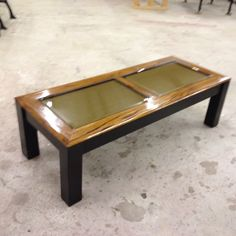 Refinished coffee table -- refinished--high gloss wood finish--ebony stain base and legs--a board covered in burlap was attached under the glass--allows new owner to display family photos safely under the glass