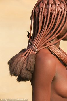 A side-on portrait of a woman from Namibia's Himba tribe, taken by Travel Photographer of the Year winner Philip Lee Harvey