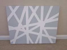 Tape up your canvas-- paint it all one color and remove the tape! Great modern design