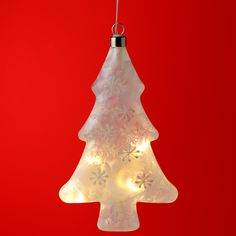 Decorative Hanging LED - Frosted Christmas Tree  Add Christmas colour and style to your home with our range of LED lights.  Complete with LED lights that require 2 AA batteries (not included), these lights are perfect for adding that magical touch to your home, garden or special event.
