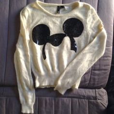 Ivory Disney sweater size 2 fits small or xs. Super soft. Fuzzy. Sequin Mickey Mouse head design. Slight pilling. I don't really care if this doesn't sell  I love it. I think it was a limited collection. OFFERS MADE THROUGH COMMENTS WILL BE IGNORED. USE OFFER BUTTON H&M Sweaters Cardigans