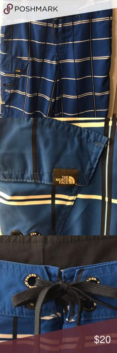 The North Face Men Blue Board Shorts Size 34 The North Face Men Blue Board Shorts Size 34 100% Polyester  Waist measurement is 35 inches  Side pocket with flap Velcro front closure with tie The North Face Shorts Flat Front