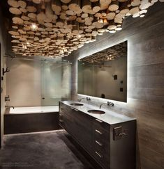 This cozy mountain cabin is infused with a mix of rustic character and modern details by Pearson Design Group, located in Harlowton, Montana. Bathroom Wall Decor, Bathroom Colors, Bathroom Styling, Bathroom Sets, Modern Bathroom, Small Bathroom, Bathroom Designs, Bathroom Lighting, Cottage Style Bathrooms