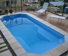 The best fiberglass swimming pools in the Daytona Beach, FL region. The best designs and colors to choose from. Contact us to learn more and get into a pool today! Fiberglass Pool Cost, Fiberglass Swimming Pools, Swimming Pool Sales, Swimming Pool Designs, Rectangle Pool, Pool Contractors, Pool Shapes, Pool Installation, Backyard Pool Designs
